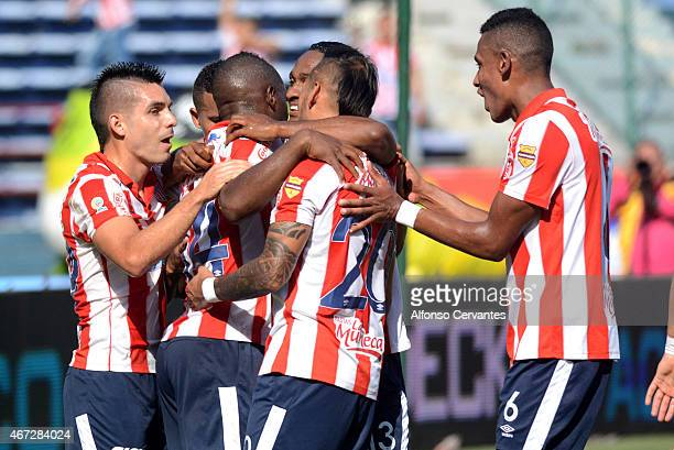 Edison Toloza of Junior celebrates with his teammates after scoring the second goal of his team during a match between Junior and Millonarios as part...