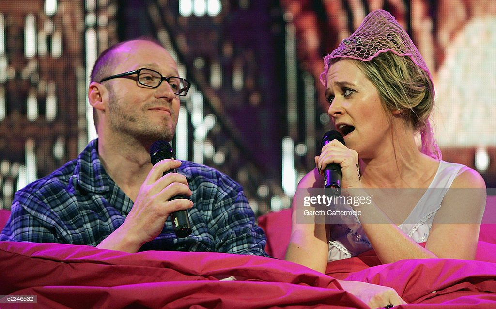DJ Edith Bowman (R) and comedian Adrian Edmondson perform Sonny & Cher's 'I Got You Babe' at the ninth eviction show for 'Comic Relief Does Fame Academy' at Lambeth College on March 9, 2005 in London. The new series sees 13 celebrities go head to head in the ultimate celebrity singing competition, with the grand final announcing the winner on March 11, Red Nose Day 2005.