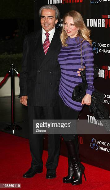 Edith Gonzalez and Lorenzo Lazo pose for a photo during the red carpet of the play Tomar Partido en el Foro Cultural Chapultepec on October 09 2012...