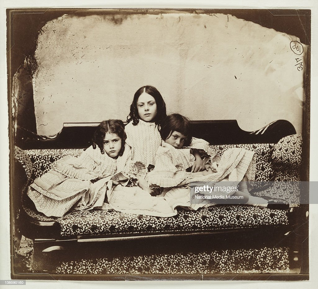 Edith, Ina and <a gi-track='captionPersonalityLinkClicked' href=/galleries/search?phrase=Alice+Liddell&family=editorial&specificpeople=977449 ng-click='$event.stopPropagation()'>Alice Liddell</a> on sofa, 1858. Photograph by Charles Lutwidge Dogson, better Known as Lewis Carroll (1832-98).