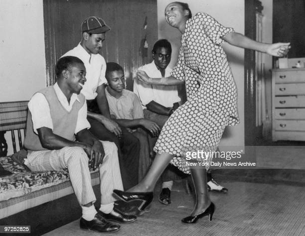 Edith Matthews shows friends and family how she won first place in the Lindy Hop