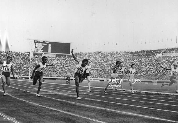 Edith McGuire Wyomia Tyus American winner of the Women's 100m and Ewa Klobukowska of Poland during the Women's 100m final at the Tokyo Olympics1964