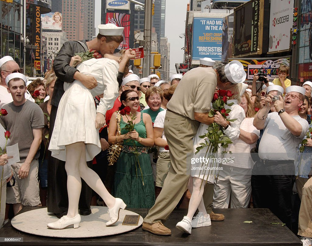 Edith Shain and Carl Muscarello, the couple that appeared in Alfred Eisenstaedt's iconic photo 'The Kiss,' appear in New York City's Times Square to reenact their famous kiss and to host a 'Kiss-In' on August 14, 2005. The sculpture titled 'Unconditional Kiss,' by Seward Johnson, depicts the kiss between Shain and Muscarello as captured by Alfred Eisenstadt on August 14, 1945 in Times Square, New York City.