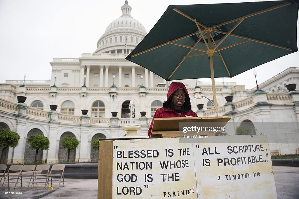 Edith Ward reads from the Bible on the west front of the Capitol during the 24th Annual U.S. Capitol Bible Reading Marathon, which features 90 hours of continuous reading.
