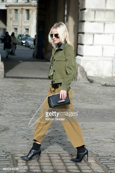 Editor and Author Celine Aagaard wears a Topshop dress Valentino sunglasses Topshop belt Vera Wang shoes and Celine shades on day 3 of London...