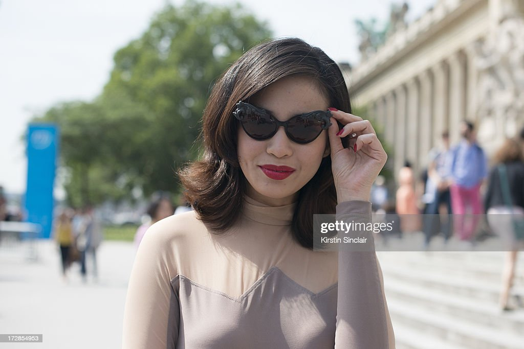 Editor and Chief of Harpers Bazaar Thailand Duang Poshyanonda wears Moo sunglasses a Vichteerut dress on day 2 of Paris Collections: Womens Haute Couture on July 02, 2013 in Paris, France.