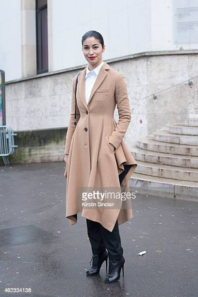 Editor and Chief of Tank Magazine Caroline Issa wears a coat trousers and shirt by Dior and Tom Ford shoes on day 2 of Paris Haute Couture Fashion...
