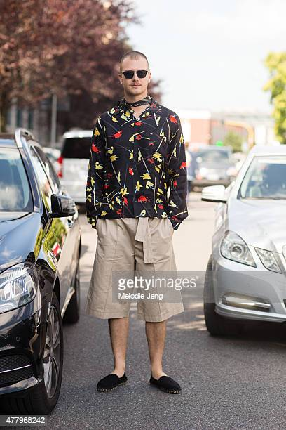 Editor Andrea Porro exits the Salvatore Ferragamo show in Pucci SS16 on June 21 2015 in Milan Italy