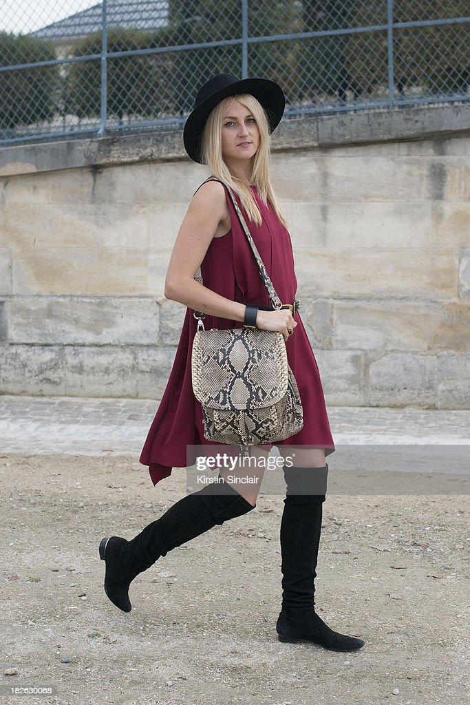 Editor at Fashionising.com Tania Braukamper wears a Jessica Choay dress, Agnes B hat, Ralph Lauren boots and a Barbara Bui bag on day 7 of Paris Fashion Week Spring/Summer 2014, Paris September 30, 2013 in Paris, France.
