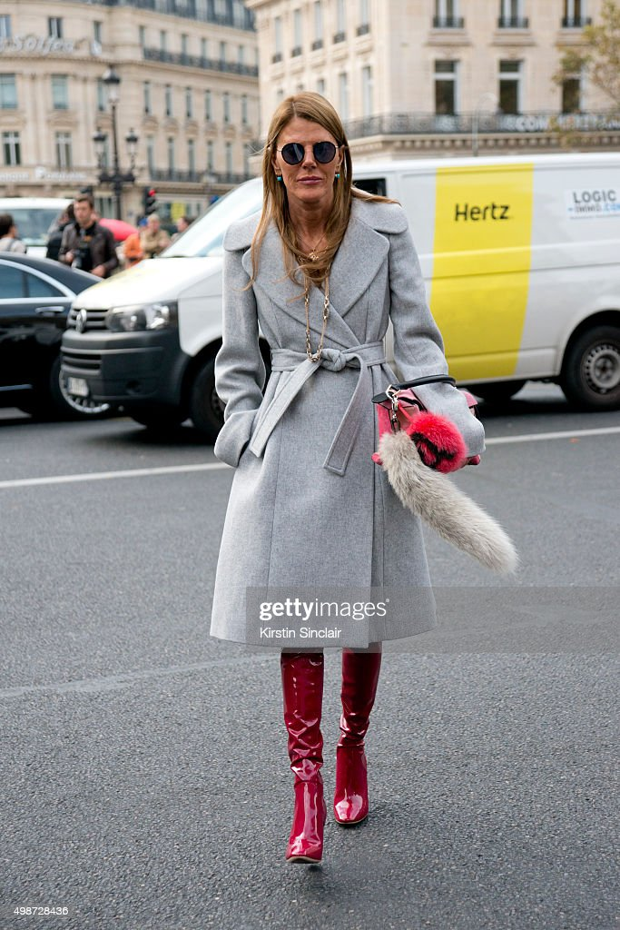 Editor At Large and Creative Consultant for Vogue Japan Anna Dello Russo wears a Stella McCartney coat Loewe bag with a Fendi pom pom Dior boots and...