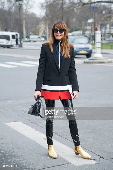 Editor at Large for Vogue Turkey Ece Sukan wears a Givenchy jacket vintage handbag and trousers Trussardi sunglasses and Saint Laurent shoes day on 3...