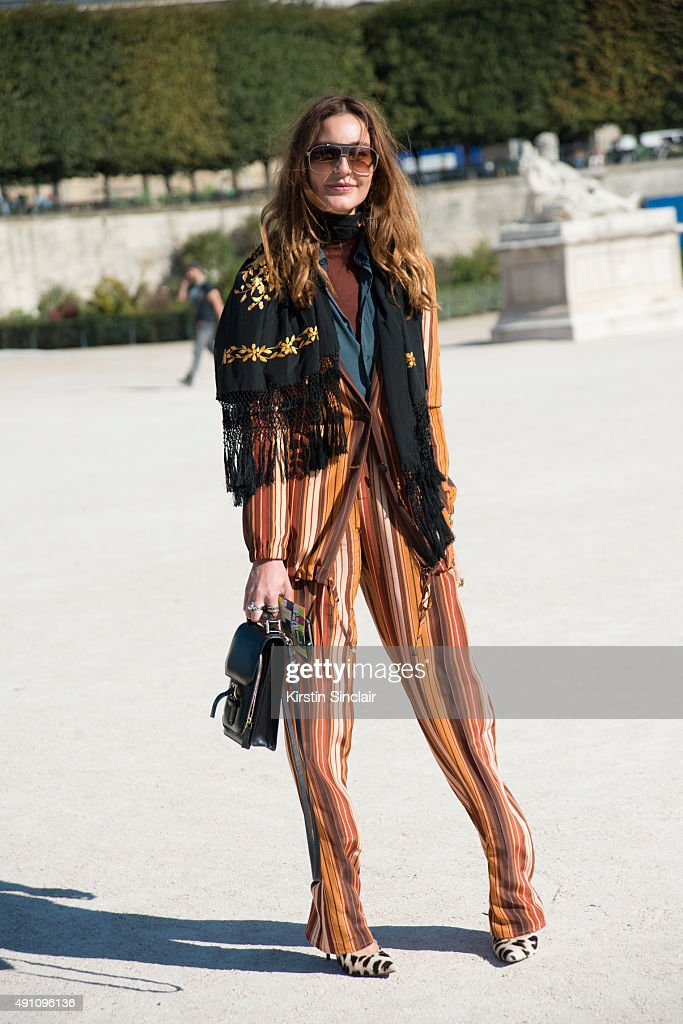 Editor at Large for Vogue Turkey Ece Sukan wears a Gucci suit vintage scarf Celine shoes and Trussardi sunglasses and bag on day 4 during Paris...