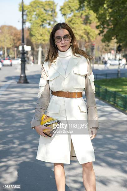Editor at Large for Vogue Turkey Ece Sukan wears an Umit Benan 1 coat Elena Ghisellini bag and Bottega Veneta sunglasses on day 5 during Paris...