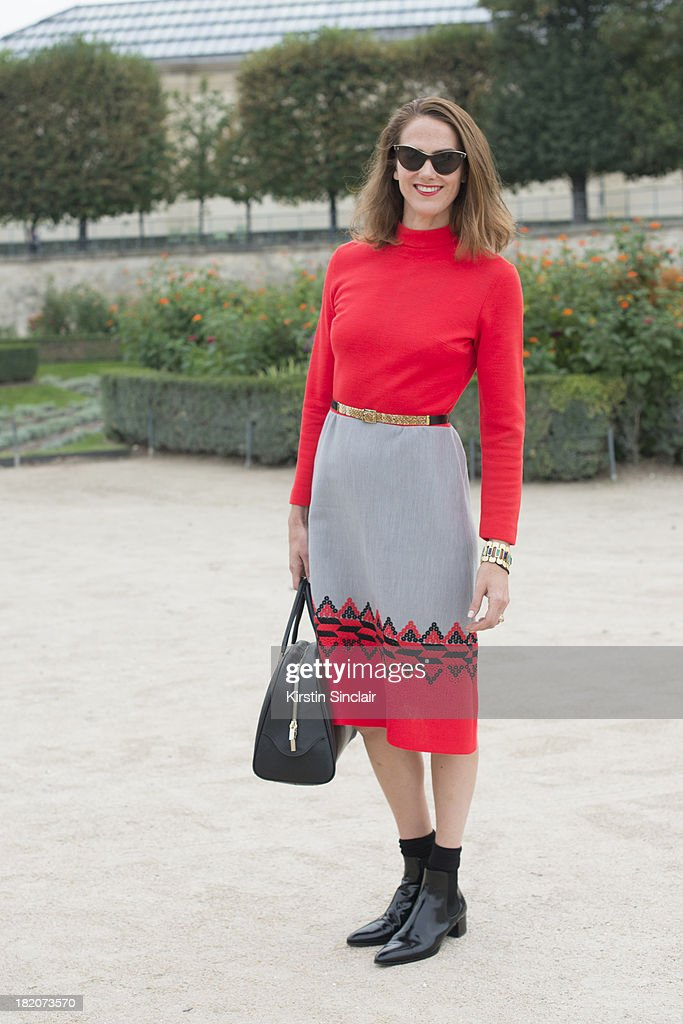Editor at large for Wallpaper magazine J J Martin wears a vintage dress, Prada shoes and a Valextra bag on day 3 of Paris Fashion Week Spring/Summer 2014, Paris September 26, 2013 in Paris, London.