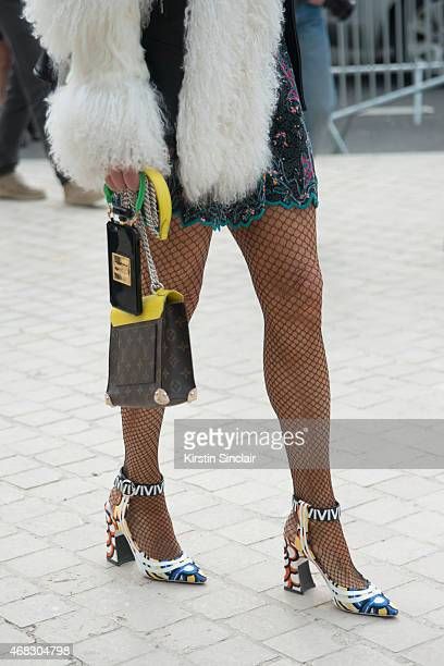 Editor at large of Vogue Japan Anna Dello Russo wears a Louis Vuitton bag and shoes on day 9 of Paris Collections Women on March 11 2015 in Paris...