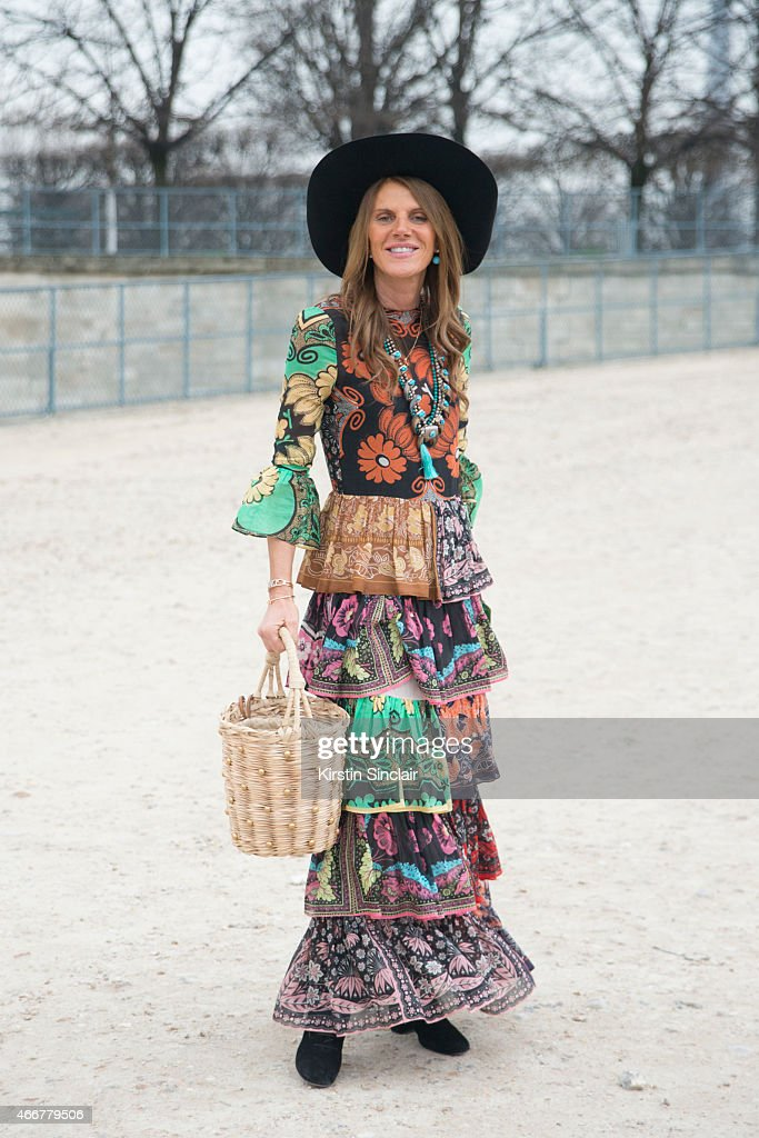 Editor at large of Vogue Japan Anna Dello Russo wears a Valentino dress and Yves Saint Laurent bag on day 8 of Paris Collections Women on March 10...