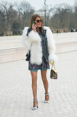 Editor at large of Vogue Japan Anna Dello Russo wears Dior sunglasses and a Louis Vuitton bag and shoes on day 9 of Paris Collections Women on March...