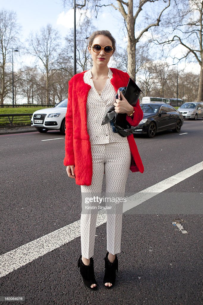Editor at Tatler Mariella Tandy wears Louis Vuitton glasses, Elizabeth and James jacket, Tara Jarmon suit, Jimmy Choo shoes and Anya Hindmarch bag on day 3 of London Womens Fashion Week Autumn/Winter 2013 on February 17, 2013 in London, England.