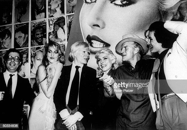 Editor Bob Colacello model Jerry Hall artist/publisher Andy Warhol singer Debbie Harry writer Truman Capote and jewelry designer Paloma Picasso at a...