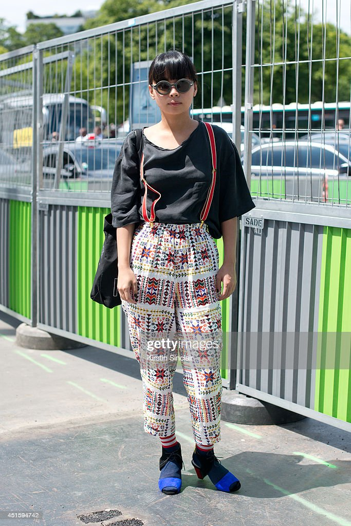 Editor for Red Magazine Japan, Chihiro Yomono wearing a Relax top, White Mountaineering trousers, Sakias shoes, G Star sunglasses and vintage socks on day 2 of Paris Collections: Men on June 26, 2014 in Paris, France.