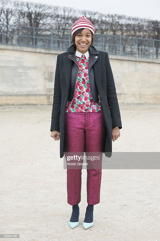 Editor in chief at Grazia Italy Tamu Mcpherson wears Marc Jacobs hat, trousers and top, Acne leather jacket, Stella McCartney coat and Gianvito Rossi shoes on day 2 of Paris Womens Fashion Week Autumn/Winter 2013 on March 1, 2013 in Paris, France.