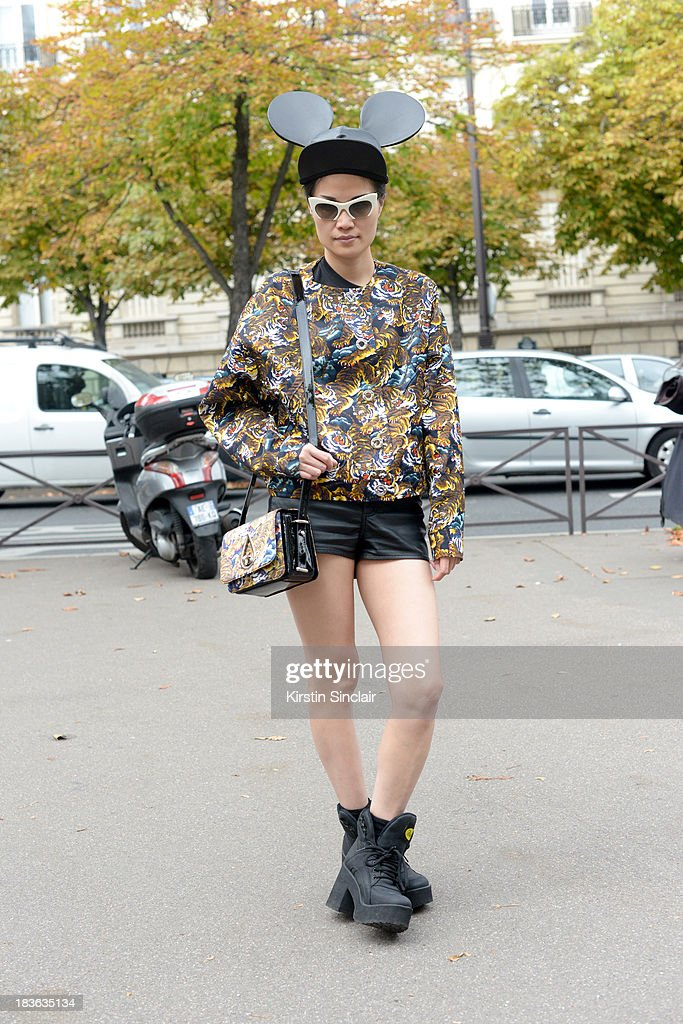 Editor in chief at Ketchup magazine Kat Yeung wearing a Kenzo jacket and bag, Miu Miu sunglasses, Comme Des Garcons hat and Buffalo boots on day 9 of Paris Fashion Week Spring/Summer 2014, Paris October 02, 2013 in Paris, France.