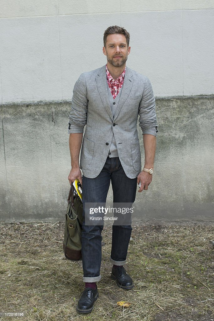 Editor in chief of 160 gram magazine Benjamin Armand wears Doc Martens shoes, J Brand jeans, Marc Jacobs cardigan, Paul Smith jacket and a Mr madone shirt on day 4 of Paris Collections: Men on June 29, 2013 in Paris, France.