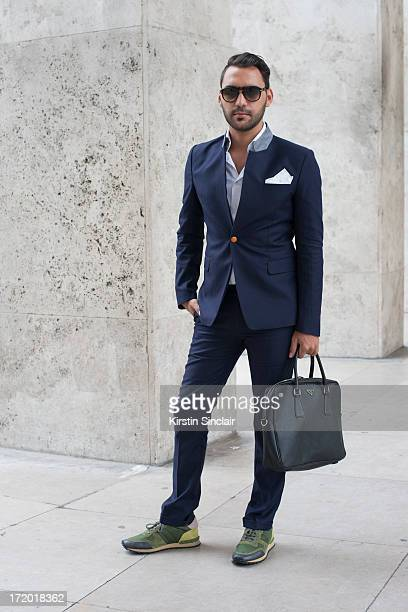 Editor in chief of AMD Mode Ahmad Daabas wears Valentino trainers Suit and shirt Tailor made in Italy Prada bag and Persol glasses on day 3 of Paris...