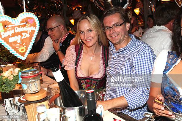 Editor in chief of GALA Anne Meyer Minnemann and her husband Claus Strunz attend the 'Almauftrieb' at Kaefer tent during Oktoberfest at...