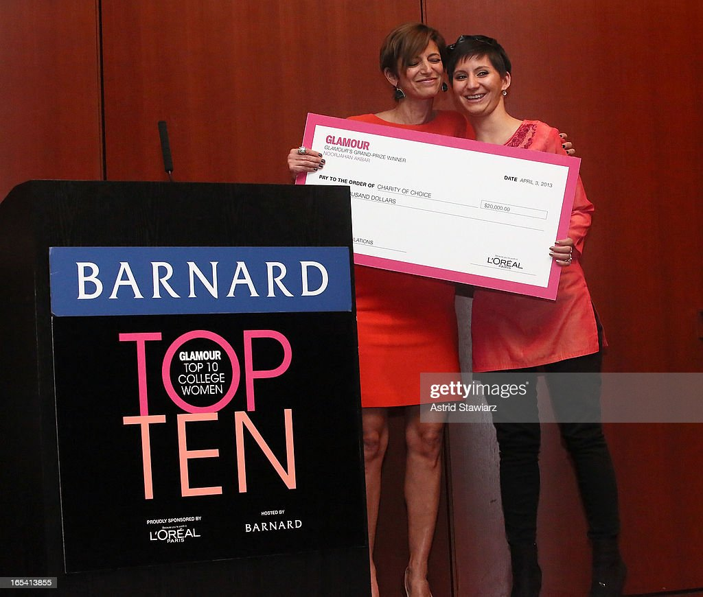 Editor in Chief of Glamour magazine, Cindi Leive and Grand prize recipient, Noorjahan Akbar pose for photos during the Glamour And L'Oreal Paris Celebration for the Top Ten College Women at The Diana Center At Barnard College on April 3, 2013 in New York City.
