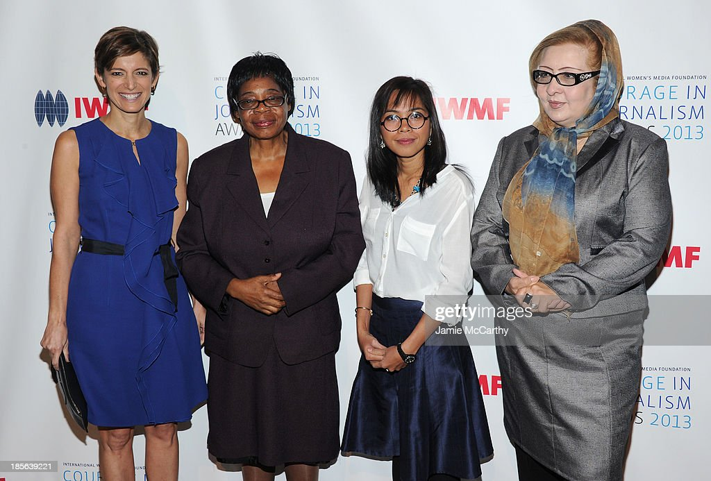 Editor in Chief of Glamour Magazine Cindi Leive, Honoree Edna Machirori, Honoree Bopha Phorn and Honoree Najiba Ayubi attend the International Women's Media Foundation's 2013 Courage In Journalism And Lifetime Achievement Awards at Cipriani 42nd Street on October 23, 2013 in New York City.