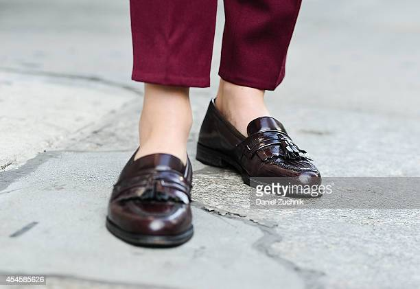 Editor in Chief of Grandpa Style Ashley Owens is seen in Nolita wearing custom trousers and vintage shoes on September 3 2014 in New York City