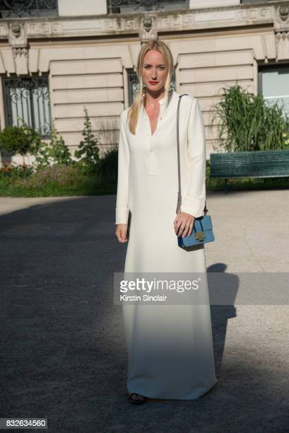 Editor in chief of Madame Magazine Petra Winter wears a Giambatista Valli dress Jimmy Choo shoes and Salvatore Ferragamo bag day 2 of Paris Haute...