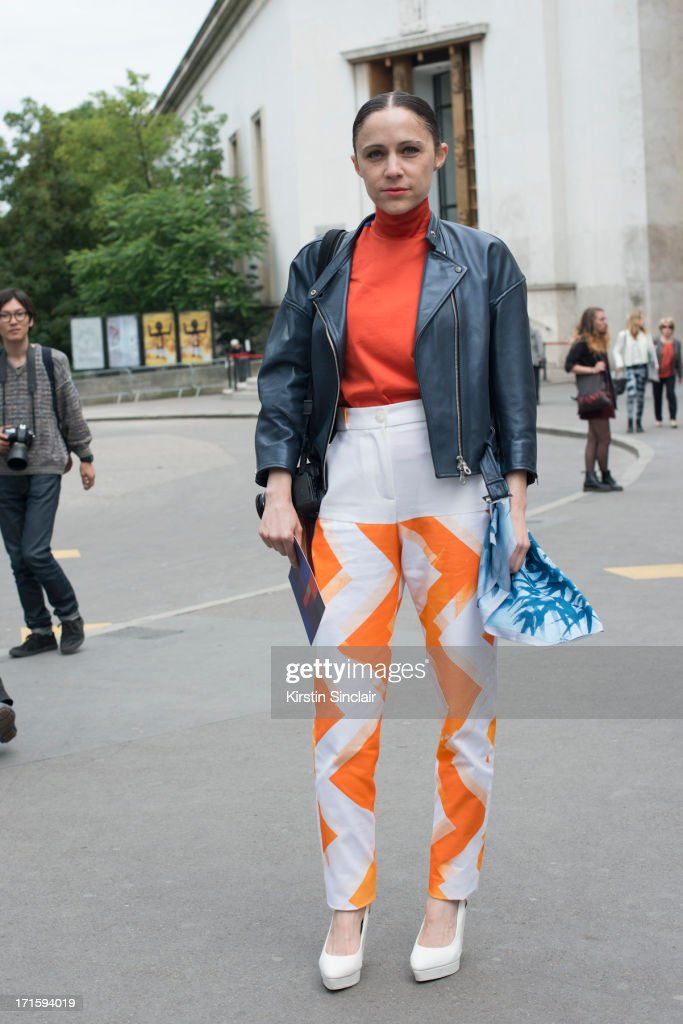 Editor in Chief of Reality Show Magazine Tiffany Godoy wears a John Lawrence Sullivan jacket and top, Eyienne Deroux trousers and a Hoiyoshi the third scarf on day 1 of Paris Collections: Men on June 26, 2013 in Paris, France.