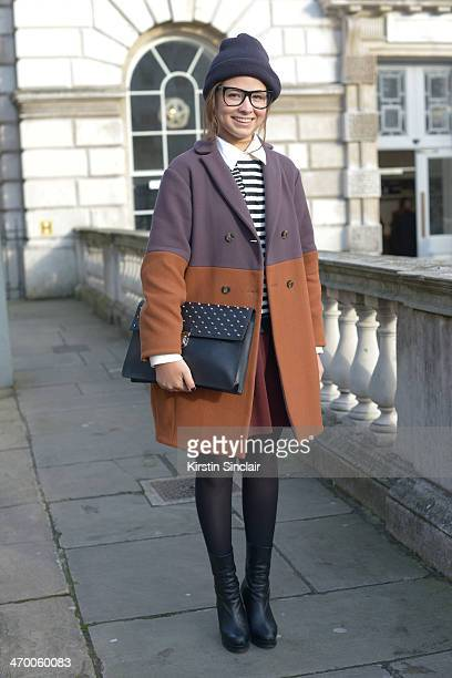Editor in Chief of Suitcase Magazine Serena Guen wears Missoni coat Prada bag Topshop boots and sweater Salvatore Ferragamo shirt and American...