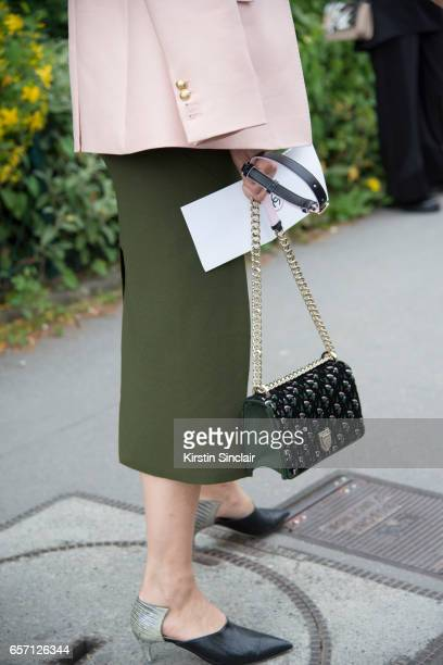 Editor in Chief of Tank Magazine Caroline Issa wears a Christopher Esber dress Dior bag and Dior shoes on day 3 of Paris Haute Couture Fashion Week...