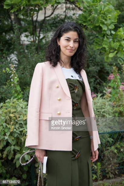 Editor in Chief of Tank Magazine Caroline Issa wears a Christopher Esber dress Dior bag on day 3 of Paris Haute Couture Fashion Week Autumn/Winter...