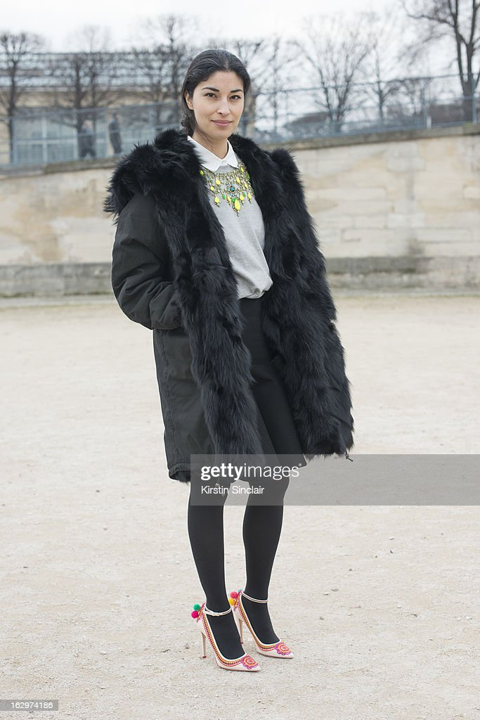 Editor in chief of Tank magazine Caroline Issa wears a Mr and Mrs Fox Parker coat, shoes by Caroline Issa for L K Bennett, Matthew Williamson sweater on day 2 of Paris Womens Fashion Week Autumn/Winter 2013 on March 1, 2013 in Paris, France.