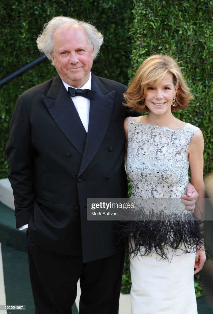 Editor in Chief of Vanity Fair Graydon Carter and Anna Scott arrive at the 2013 Vanity Fair Oscar Party at Sunset Tower on February 24, 2013 in West Hollywood, California.