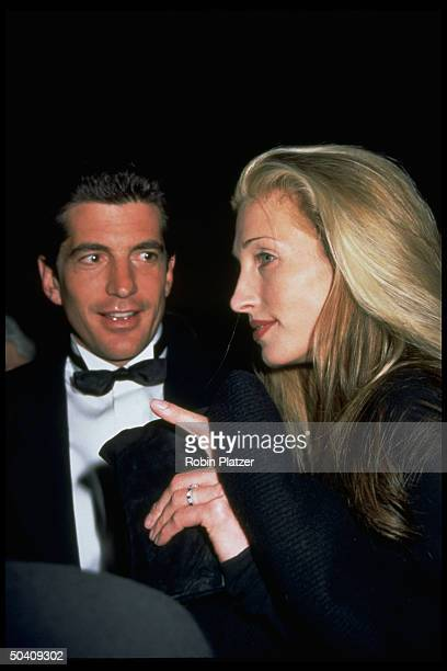 GEORGE editor John F Kennedy Jr publicist fiancee Carolyn Bessette at unident event