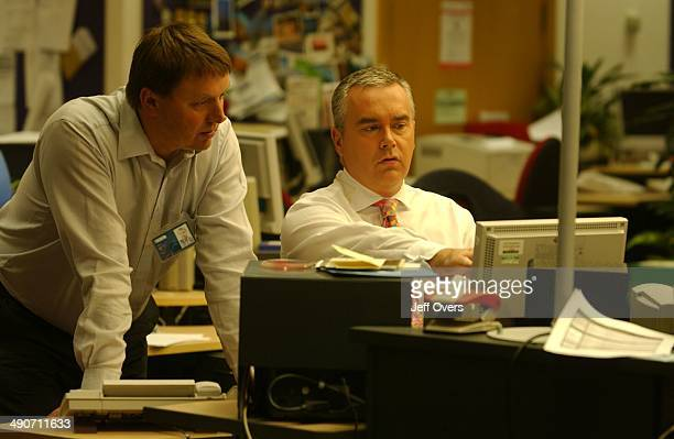Editor Mark Popescu and Presenter Huw Edwards in the BBC Newsroom