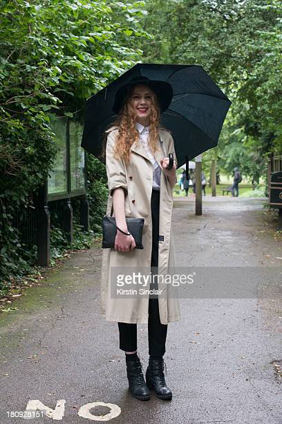 Editor of 1883 magazine Ginger Clarke wears Urban Outfitters boots vintage jacket Gap shirt Asos trousers American Apparel hat and a Kurt Geiger bag...