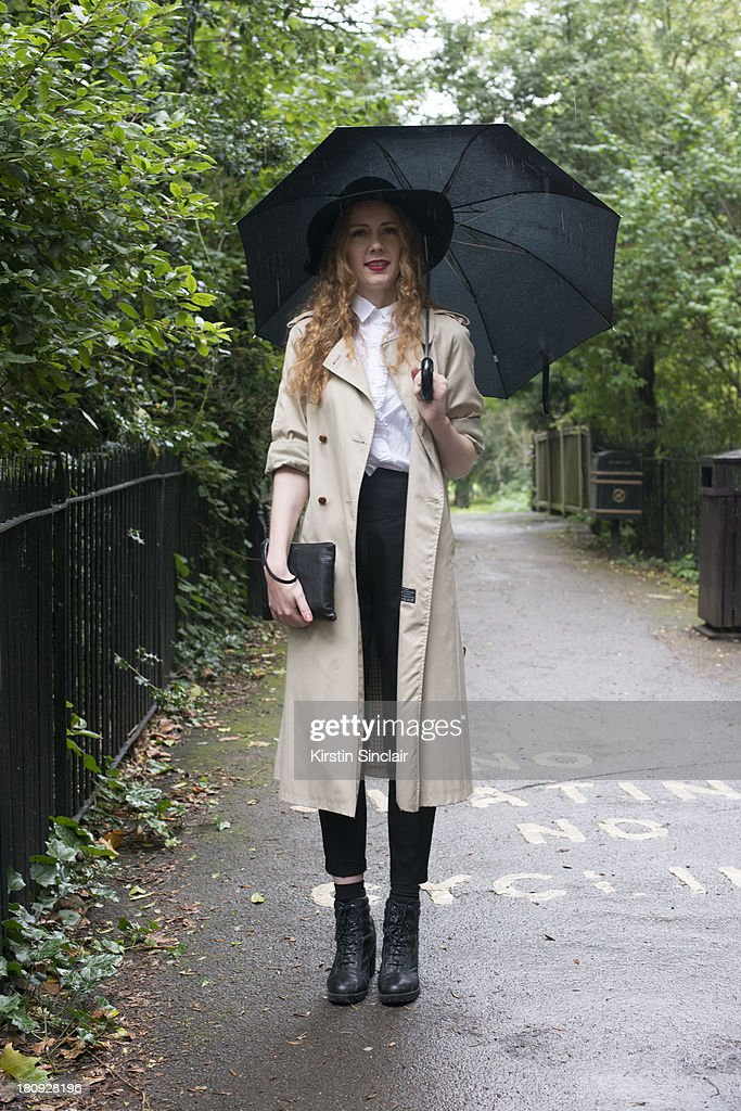 Editor of 1883 magazine Ginger Clarke wears Urban Outfitters boots, vintage jacket, Gap shirt, Asos trousers, American Apparel hat and a Kurt Geiger bag on day 5 of London Fashion Week Spring/Summer 2013, at Somerset House on September 17, 2013 in London, England.