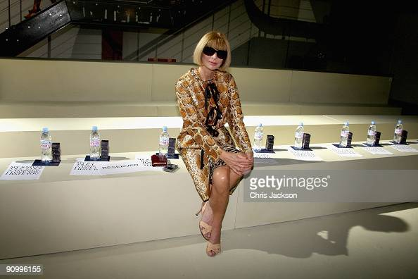 Editor of American Vogue Anna Wintour poses for a photograph as she sits on her own in the front row of the Meadham Kirchoff Spring/Summer 2010 show...