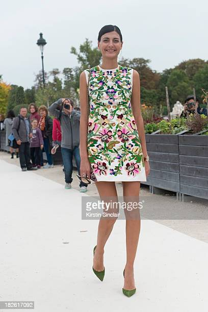 Editor of L'Uomo Vogue and freelance stylist Giovanna Battaglia wearing a Valentino dress Cherouke bag and Manolo Blahnik shoes on day 8 of Paris...
