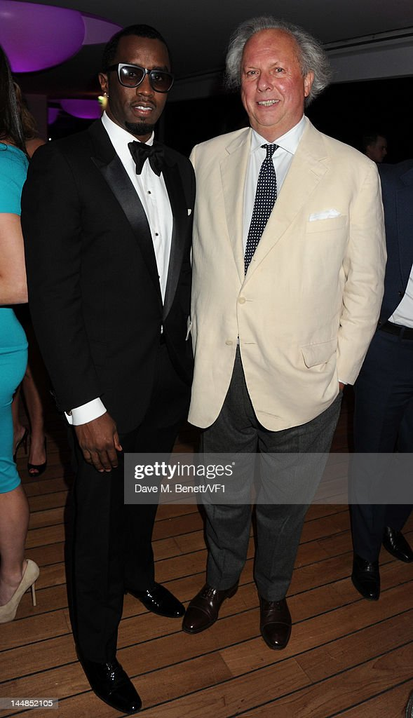 Editor of Vanity Fair Graydon Carter (R) and actor Sean Combs attends the Vanity Fair And Gucci Party during the 65th Annual Cannes Film Festival at Hotel Du Cap on May 19, 2012 in Antibes, France.