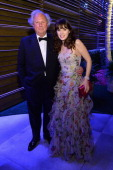 Editor of Vanity Fair Graydon Carter and actress Zooey Deschanel attend the 2014 Vanity Fair Oscar Party Viewing Dinner Hosted By Graydon Carter on...