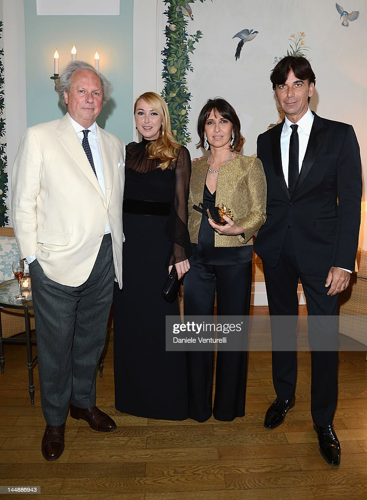 GUCCI Editor of Vanity Fair Graydon Carter, Creative Director Frida Giannini, guest and GUCCI President & CEO Patrizio di Marco attend the Vanity Fair and Gucci Party at Hotel Du Cap during 65th Annual Cannes Film Festival on May 19, 2012 in Antibes, France.