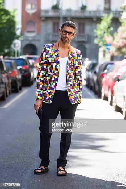 Editor Simone Marchetti wears Loewe during Milan Men's Fashion Week Spring/Summer 2016 on June 20 2015 in Milan Italy