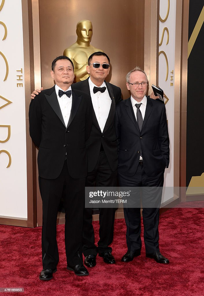 Editor William Chang Suk Ping, director Wong Kar-wai and cinematographer Philippe Le Sourd attend the Oscars held at Hollywood & Highland Center on March 2, 2014 in Hollywood, California.